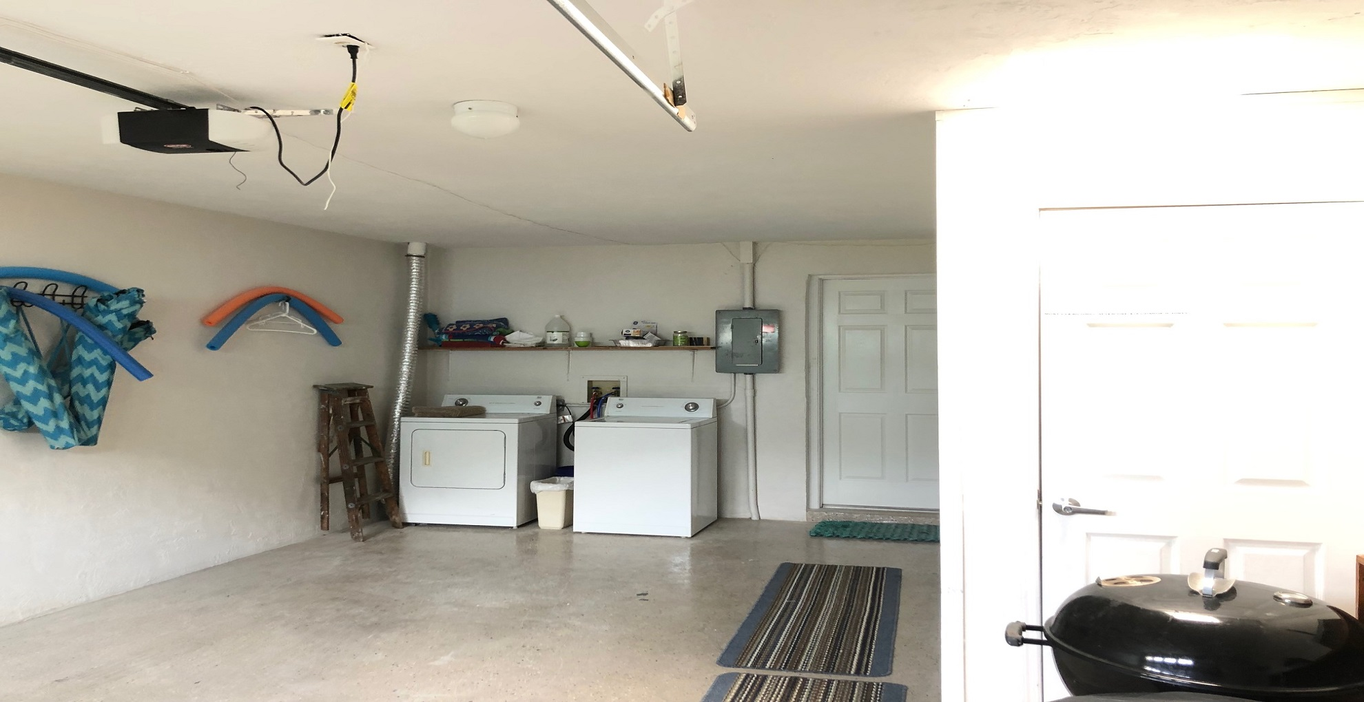 Garage with full size laundry